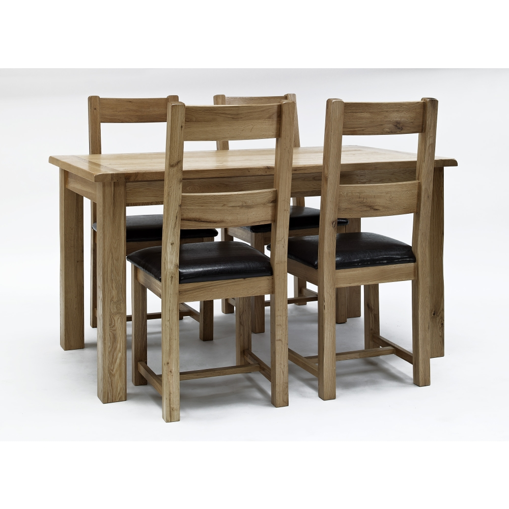 westbury solid oak furniture dining table and four dining